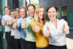 Cheering business team holding thumbs up Stock Images