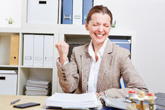 Cheering business woman clenching Royalty Free Stock Image