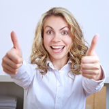 Cheering business woman holding Stock Image
