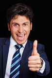 Cheering businessman holding thumb up Stock Image