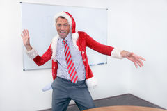 Cheering businessman in Santa´s costume. Cheereing businessman have a fun in Santa´s costume in office Royalty Free Stock Photography