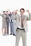Cheering businessman with team behind him Stock Photo