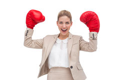 Cheering businesswoman with boxing gloves Stock Photography