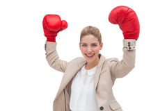 Cheering businesswoman wearing boxing gloves Royalty Free Stock Photo