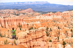 Cheering celebrating happy hiker in Bryce Canyon. Standing enjoying view with arms raised outstretched in winning success movement. Joyful hiking man tourist on Stock Photography