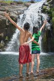 Cheering couple on waterfall Stock Photo
