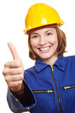 Cheering craftswoman holding thumbs Royalty Free Stock Image