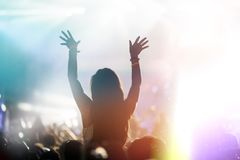 Cheering crowd at concert enjoying music performance royalty free stock photo