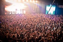 Cheering crowd at David Guetta's perfomance Royalty Free Stock Image