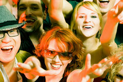 Cheering crowd in disco club. Crowd cheering - their rock idol or simply having fun in a club or disco party Stock Images