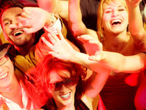 Cheering crowd in disco club. Crowd cheering - their rock idol or simply having fun in a club or disco party Stock Photo