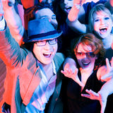Cheering crowd in disco club. Crowd cheering - their rock idol or simply having fun in a club or disco party Royalty Free Stock Photo