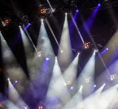 Cheering crowd. In front of bright stage lights Royalty Free Stock Photography