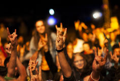 Cheering crowd in front of stage lights Royalty Free Stock Photos