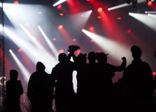 Cheering crowd in front of stage lights Stock Image