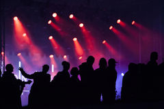Cheering crowd in front of stage lights Royalty Free Stock Image
