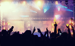 Cheering crowd in front of stage lights - retro photo Royalty Free Stock Image