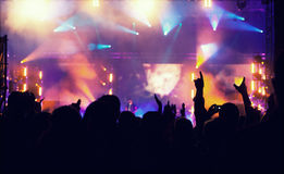 Cheering crowd in front of stage lights - retro photo Stock Photos