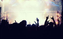 Cheering crowd in front of stage lights - retro photo Royalty Free Stock Photos