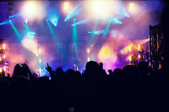 Cheering crowd in front of stage lights - retro photo Royalty Free Stock Photography