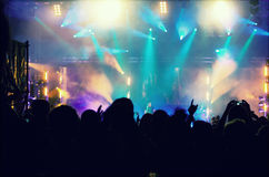 Cheering crowd in front of stage lights - retro photo Stock Photo