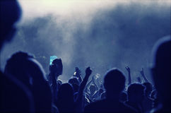 Cheering crowd in front of stage lights - retro photo Royalty Free Stock Images