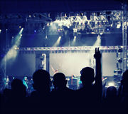 Cheering crowd in front of stage lights - retro photo Royalty Free Stock Photo