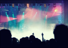 Cheering crowd in front of stage lights - retro photo Stock Image