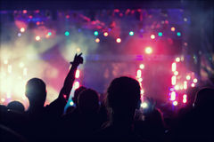 Cheering crowd in front of stage lights - retro photo Stock Photography