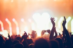 Cheering crowd with hands in air at music festival. Cheering crowd with hands in air enjoying at music festival Royalty Free Stock Photos