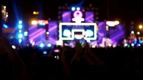 Cheering crowd people enjoying outdoor music concert festival. stock video