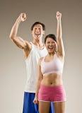 Cheering do homem e da mulher Imagens de Stock