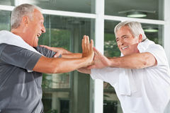 Cheering elderly man in fitness Stock Photo