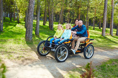 Cheering Family in Bike Car royalty free stock photography