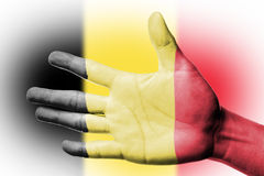 Cheering fan with Painting Belgium national flag with your hand Stock Photo
