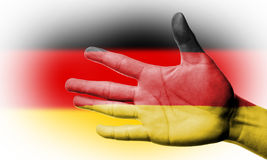 Cheering fan with Painting German national flag with your hand Royalty Free Stock Photos