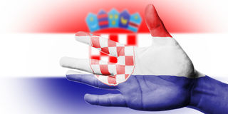 Cheering fan with Painting national Croatia flag with your hand Royalty Free Stock Photo