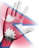 Cheering fan with Painting national Nepal  flag. With your hand with your hand for cheer your national sport Royalty Free Stock Photo