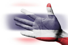 Cheering fan with Painting Thailand national flag with your hand Royalty Free Stock Images