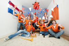 Cheering fans. Group of ten cheering sports fans watching their national sports team at home Stock Images