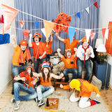 Cheering fans and soccer hater Royalty Free Stock Photo