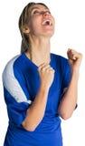 Cheering football fan in blue jersey Royalty Free Stock Photo
