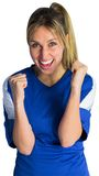 Cheering football fan in blue jersey Royalty Free Stock Photography