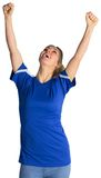 Cheering football fan in blue jersey Royalty Free Stock Photo