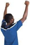 Cheering football fan in blue jersey Royalty Free Stock Image