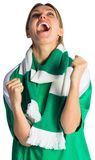 Cheering football fan in green jersey Royalty Free Stock Photos