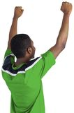 Cheering football fan in green jersey Royalty Free Stock Images