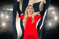 Cheering football fan in red holding greece flag Royalty Free Stock Image