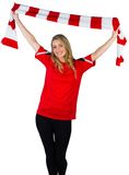 Cheering football fan in red Stock Photo