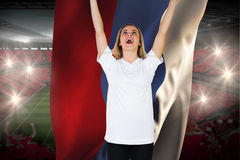 Cheering football fan in white holding russia flag Stock Photo